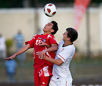 Marc Pelosi (11) of the United States goes up for a header with Bryan Santamaria (17) of Panama during the group stage of the CONCACAF Men's Under 17 Championship at Jarrett Park in Montego Bay, Jamaica. The USA defeated Panama, 1-0.