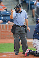 Home plate umpire David Rackley makes a strike call during an International League game between the Lehigh Valley IronPigs and the Durham Bulls at Durham Bulls Athletic Park June 26, 2010, in Durham, North Carolina.  Photo by Brian Westerholt / Four Seam Images