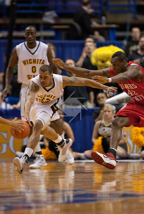 March 6,  2010            Wichita State forward Gabe Blair (32, left) and Illinois State forward Dinma Odiakosa (42) both race for a ball which was ultimately scooped up by (only partially visible) Wichita State guard Demetric Williams (5) in the first half.  Wichita State defeated Illinois State by a score of 65-61 in the second of two semifinals played on Saturday March 6, 2010 at the Missouri Valley Conference Tournament.  The tournament is being held at the Scottrade Center in downtown St. Louis.  Wichita State advances to play the University of Northern Iowa for the MVC Tournament Championship.  The winner earns an automatic berth in the NCAA Tournament.