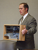 An unidentified person holds a model of the trunk lid and hole that was cut in the trunk of the Chevrolet Caprice that sniper suspect John Allen Muhammad was captured in during court proceedings in Virginia Beach Circuit Court in Virginia Beach, Virginia, November 6, 2003. <br /> Credit: Tracy Woodward - Pool via CNP