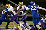 SIOUX FALLS, SD - OCTOBER 25: Trevor Peters #21 from Winner looks upfield past Mitchell Goodbary #22 from Sioux Falls Christian in the first half of their 11B playoff game Thursday nigh at Bob Young Field in Sioux Falls.(Photo by Dave Eggen/Inertia)
