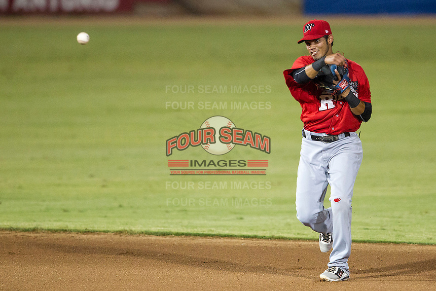 Frisco Roughriders shortstop Luis Sardinas (2) makes a throw to first base in the Texas League baseball game against the San Antonio Missions on August 22, 2013 at the Nelson Wolff Stadium in San Antonio, Texas. Frisco defeated San Antonio 2-1. (Andrew Woolley/Four Seam Images)