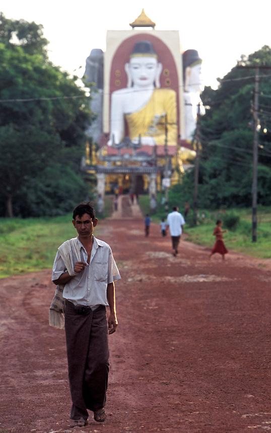 A Burmese man walks down a road away from the Kiayk Pun Pagoda, Bago, Burma, 2006.