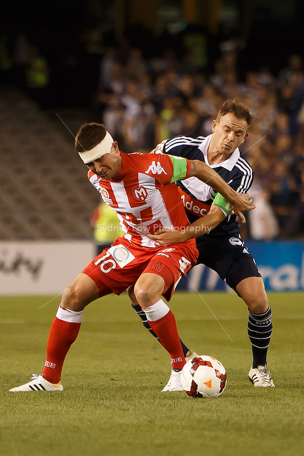Harry Kewell, captain of the Heart, protects the ball in the round one match between Melbourne Victory and Melbourne Heart in the Australian Hyundai A-League 2013-24 season at Etihad Stadium, Melbourne, Australia.<br /> This image is not for sale. Please visit zumapress.com for image licensing.