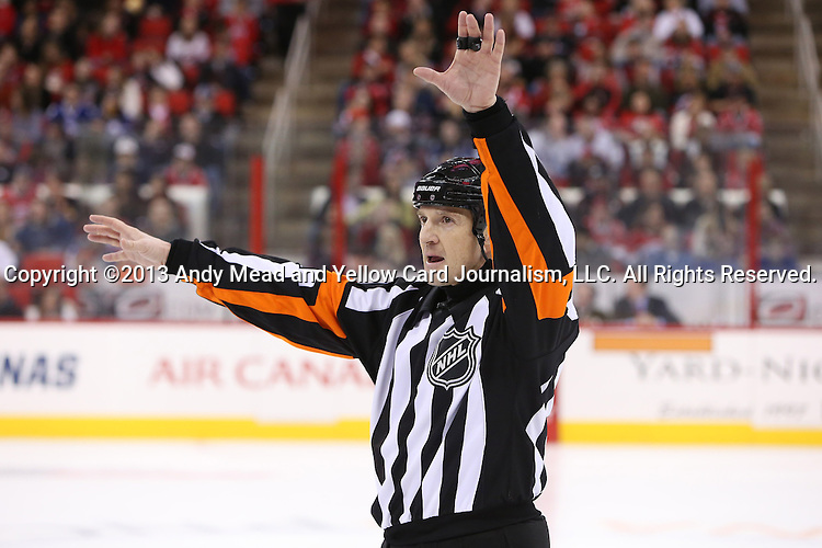 14 February 2013: Referee Tim Peel. The Carolina Hurricanes played the Toronto Maple Leafs at the PNC Arena in Raleigh, North Carolina in a 2012-2013 National Hockey League regular season game. Carolina won the game 3-1.
