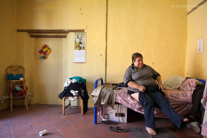 Normota, a resident of Casa Xochiquetzal, puts her pants on in her bedroom at the shelter in Mexico City, Mexico on October 4, 2012. Casa Xochiquetzal is a shelter for elderly sex workers in Mexico City. It gives the women refuge, food, health services, a space to learn about their human rights and courses to help them rediscover their self-confidence and deal with traumatic aspects of their lives. Casa Xochiquetzal provides a space to age with dignity for a group of vulnerable women who are often invisible to society at large. It is the only such shelter existing in Latin America. Photo by Bénédicte Desrus