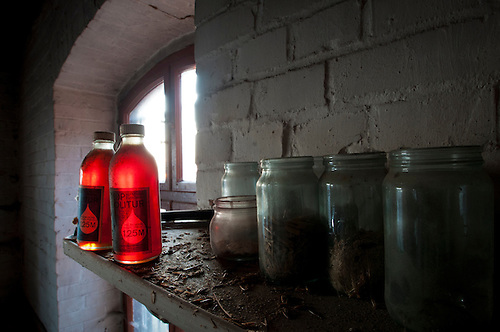 An old abandoned mill in a very small East German Village. Some old forgotten bottle and jars.