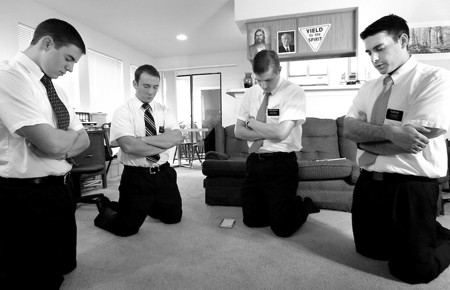 Missionaries from The Church of Jesus Christ of Latter-day Saints (from left) Elders Adams, Allen, Carlston and Diaz, pray as they do daily, at precisely 8am, in their Durham apartment before a 12-hour day of proselytizing and community service.