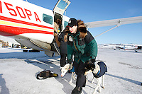 Laura Dagereau , who scratched in in Grayling, takes her dogs out of the Penair Caravan plane in Unalakleet Tuesday afternoon.   Iditarod 2009