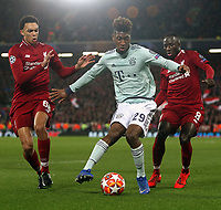 Bayern Munich's Kingsley Coman under pressure from Liverpool's Trent Alexander-Arnold (left) and Naby Keita<br /> <br /> Photographer Rich Linley/CameraSport<br /> <br /> UEFA Champions League Round of 16 First Leg - Liverpool and Bayern Munich - Tuesday 19th February 2019 - Anfield - Liverpool<br />  <br /> World Copyright © 2018 CameraSport. All rights reserved. 43 Linden Ave. Countesthorpe. Leicester. England. LE8 5PG - Tel: +44 (0) 116 277 4147 - admin@camerasport.com - www.camerasport.com