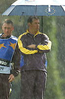 Ryder Cup K Club Straffin Co Kildare..European Ryder Cup Team player Lee Westwood shelters from the rain on the 17th green during the morning fourball session of the second day of the 2006 Ryder Cup at the K Club in Straffan, County Kildare, in the Republic of Ireland, 23 September, 2006..Photo: Barry Cronin/ Newsfile.