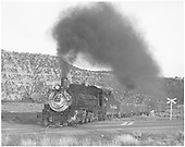 3/4 fireman side view of K-36 #483 at road crossing in Bondad area ?<br /> D&amp;RGW  Bondad area, CO