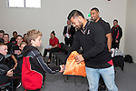 Roller Mills halfback Harrison Clotworthy receives a prize pack from Steeler Jordan Taufua. Counties Manukau Rugby Unions Junior Prize giving held at ECOLight stadium on Thursday October 22nd 2015. Photo by Richard Spranger