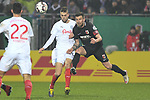 06.02.2019,  GER; DFB Pokal, Holstein Kiel vs FC Augsburg ,DFL REGULATIONS PROHIBIT ANY USE OF PHOTOGRAPHS AS IMAGE SEQUENCES AND/OR QUASI-VIDEO, im Bild Daniel Baier (Augsburg #10) versucht sich gegen Jonas Meffert (Kiel #26) durchzusetzen Foto © nordphoto / Witke *** Local Caption ***