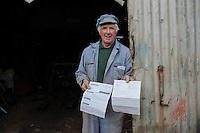 Wednesday 26 March 2014<br /> Pictured: Mr Rees shows the paperwork relating to the fines the tractor has received<br /> Re: Robert Rees received two fines for his 70-year-old tractor from two London boroughs - even though it had never left his Pembrokeshire village