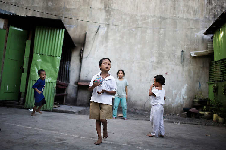 Children play in a squatter village in Manila, Philippines.