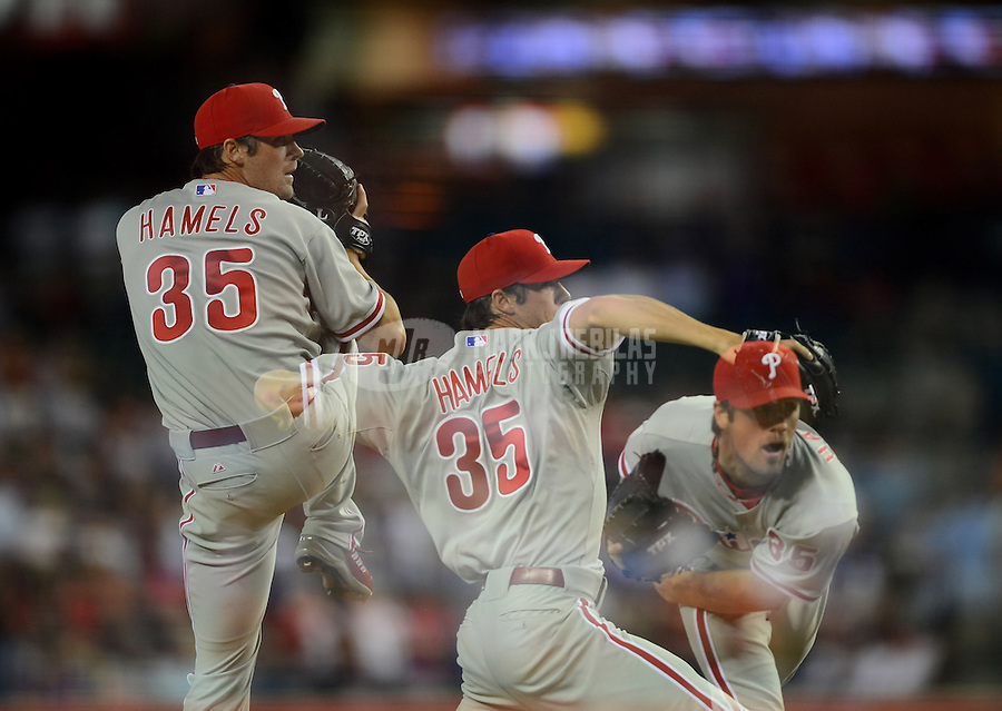 Apr. 25, 2012; Phoenix, AZ, USA; (Editors note: Multiple Exposure image) Philadelphia Phillies pitcher Cole Hamels throws in the fifth inning against the Arizona Diamondbacks at Chase Field. Mandatory Credit: Mark J. Rebilas-