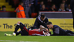 Kieron Freeman of Sheffield Utd receives treatment during the League One match at Bramall Lane Stadium, Sheffield. Picture date: September 27th, 2016. Pic Simon Bellis/Sportimage