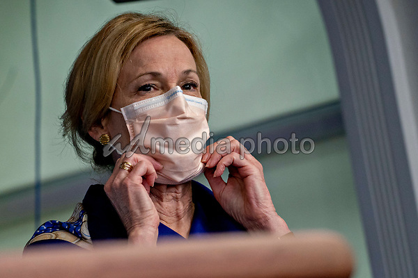 Ambassador Deborah L. Birx, M.D., White House Coronavirus Response Coordinator, adjusts her protective mask during a news conference in the Brady Press Briefing Room of the White House in Washington, D.C., U.S., on Friday, May 22, 2020. United States President Donald J. Trump did not wear a face mask during most of his tour of Ford Motor Co.'s ventilator facility Thursday, defying the automaker's policies and seeking to portray an image of normalcy even as American coronavirus deaths approach 100,000. <br /> Credit: Andrew Harrer / Pool via CNP/AdMedia