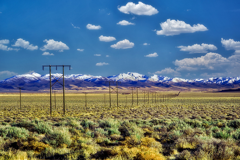 Miles of power lines with Trout Creek Mountains, near Fields Oregon.