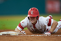 Hunter Kasuls (19) of the Louisiana Ragin' Cajuns dives head first back towards first base during the game against the Mississippi State Bulldogs in game three of the 2018 Shriners Hospitals for Children College Classic at Minute Maid Park on March 2, 2018 in Houston, Texas.  The Bulldogs defeated the Ragin' Cajuns 3-1.   (Brian Westerholt/Four Seam Images)
