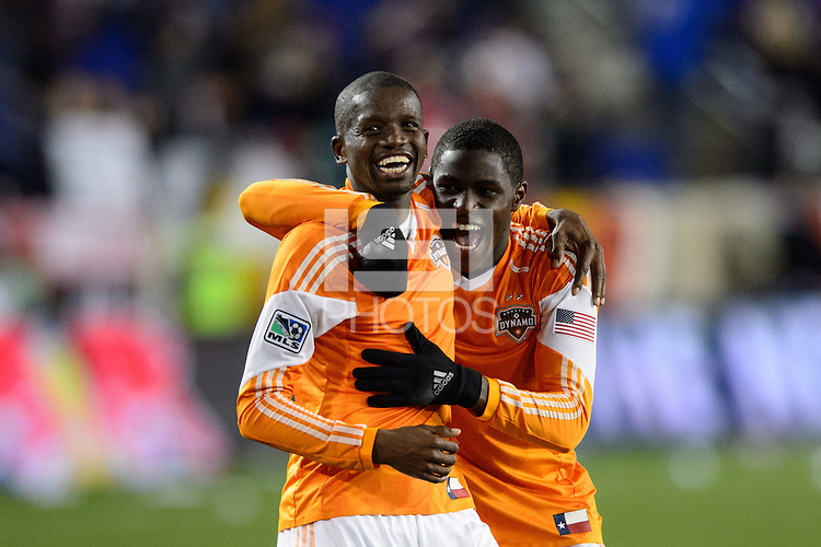 Boniek Garcia (27) and Kofi Sarkodie (8) of the Houston Dynamo celebrate after the match. The Houston Dynamo defeated the New York Red Bulls 2-1 (4-3 on aggregate) in overtime of the second leg of the Major League Soccer (MLS) Eastern Conference Semifinals at Red Bull Arena in Harrison, NJ, on November 6, 2013.