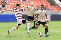 Houston, TX - Friday December 11, 2016: Foster Langsdorf (2) of the Stanford Cardinal attempts to strip the ball from Jacori Hayes (8) of the Wake Forest Demon Deacons at the NCAA Men's Soccer Finals at BBVA Compass Stadium in Houston Texas.