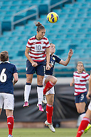 February 9, 2013:  USA Women's National Team midfielder Carli Lloyd (10) goes up high over Scotland midfielder Leanne Crichton (14) for a header during action between the USA Women's National Team and Scotland at EverBank Field in Jacksonville, Florida.  USA defeated Scotland 4-1............