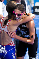 05 JUN 2010 - MADRID, ESP - Bronze medallist Helen Jenkins congratulates runner up Emmie Charayron at the finish of the Madrid round of the womens ITU World Championship Series triathlon .(PHOTO (C) NIGEL FARROW)