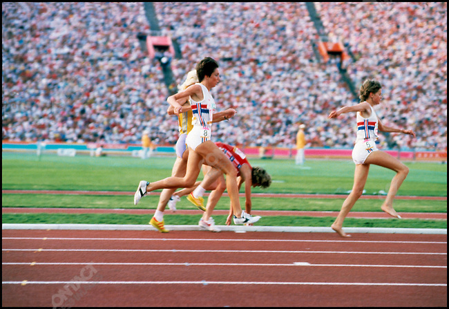 Mary Decker (USA) trips and her rival Zola Budd (UK) takes the lead in the 3000 meter final. Summer Olympics, Los Angeles, California, USA, August 1984.