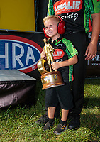 Sep 3, 2018; Clermont, IN, USA; Cameron McMillen, son of NHRA top fuel driver Terry McMillen (not pictured) celebrates with the Wally trophy after winning the US Nationals at Lucas Oil Raceway. Mandatory Credit: Mark J. Rebilas-USA TODAY Sports