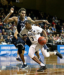 SIOUX FALLS, SD - MARCH 20: Shaun Willet #3 from Queens University looks to get a step past Dejon Davis #44 from Cal Baptist during their quarterfinal game at the 2018 Elite Eight Men's NCAA DII Basketball Championship at the Sanford Pentagon in Sioux Falls, SD. (Photo by Dave Eggen/Inertia)