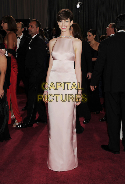 Anne Hathaway (wearing Prada).85th Annual Academy Awards held at the Dolby Theatre at Hollywood & Highland Center, Hollywood, California, USA..February 24th, 2013.oscars full length pink sleeveless silk satin dress  .CAP/ROT/TM.©Tony Michaels/Roth Stock/Capital Pictures
