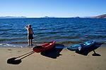 A kayaker scouts Bahia de los Angeles on the Sea of Cortez (Gulf of California), Baja California, Mexico