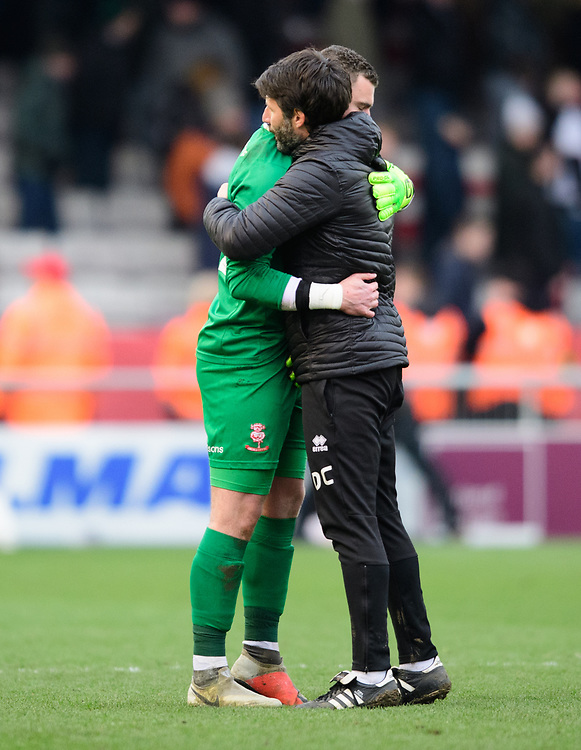 Lincoln City manager Danny Cowley, right, hugs Lincoln City's Grant Smith at the end of the game<br /> <br /> Photographer Chris Vaughan/CameraSport<br /> <br /> The EFL Sky Bet League Two - Lincoln City v Grimsby Town - Saturday 19 January 2019 - Sincil Bank - Lincoln<br /> <br /> World Copyright &copy; 2019 CameraSport. All rights reserved. 43 Linden Ave. Countesthorpe. Leicester. England. LE8 5PG - Tel: +44 (0) 116 277 4147 - admin@camerasport.com - www.camerasport.com