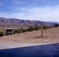View from a terrace out over the barren landscape and distant mountain range
