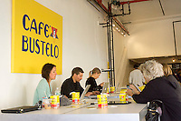 Visitors take advantage of free wi-fi at the Cafe Bustelo pop-up store on the Lower East Side of New York on Friday, October 17, 2014.  (© Richard B. Levine)
