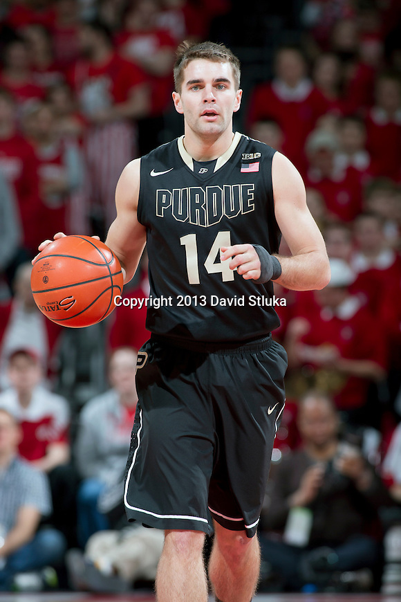 Purdue Boilermakers guard Dru Anthrop (14) handles the ball during a Big Ten Conference NCAA college basketball game against the Wisconsin Badgers Sunday, March 3, 2013, in Madison, Wis. Purdue won 69-56. (Photo by David Stluka)