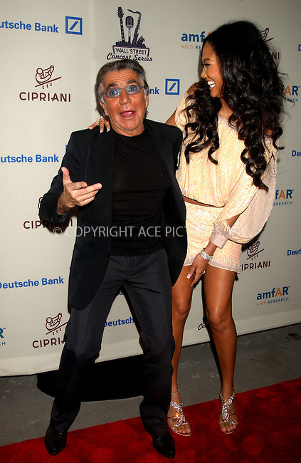 WWW.ACEPIXS.COM . . . . .....November 7, 2006, New York City. ....Kimora Lee Simmons and Roberto Cavalli attend the Cipriani & Deutsche Bank Concert Series with amfAR Benefit Auction hosted by Sharon Stone.....Please byline: KRISTIN CALLAHAN - ACEPIXS.COM.. . . . . . ..Ace Pictures, Inc:  ..(212) 243-8787 or (646) 769 0430..e-mail: info@acepixs.com..web: http://www.acepixs.com