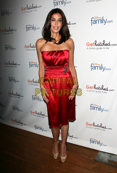 "TERI HATCHER .Disney Family.com and award winning actress Teri Hatcher kicks-off the launch joint web project ""GetHatched.com"" held at Rouge Tomate, New York, NY, USA..May 10th, 2010.full length dress silk satin gold peep toe shoes red strapless .CAP/ADM/PZ.©Paul Zimmerman/AdMedia/Capital Pictures."