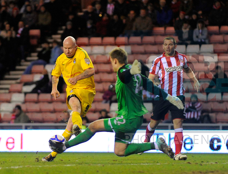 Sunderland's Simon Mignolet saves a shot from Notts County's Lee Hughes.