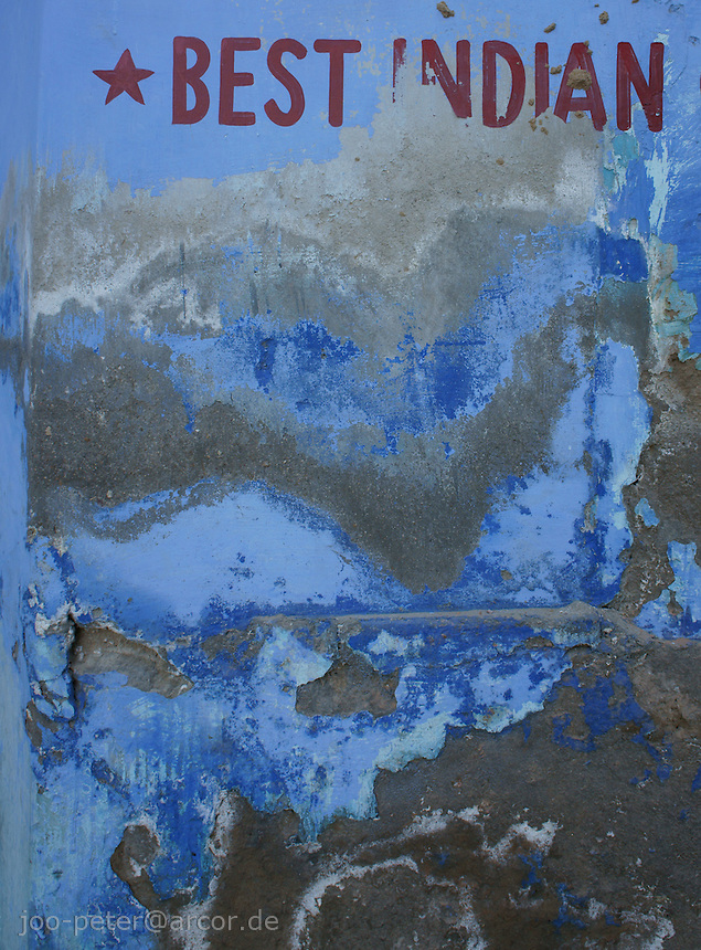 """wall with  letter painting """"best india"""" and blue wall paint patina in Jodhpur, Rajastan, India"""