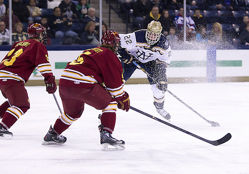 January 25, 2013:  Notre Dame left wing Mario Lucia (22) shoots the puck as Ferris State defensemen Connor Schmidt (5) and Brandon Anselmini (23) defend during NCAA Hockey game action between the Notre Dame Fighting Irish and the Ferris State Bulldogs at Compton Family Ice Arena in South Bend, Indiana.  Ferris State defeated Notre Dame 3-1.