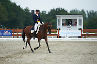 Aistis Vitkauskas (LTU) riding AK's  Galopper  during the dressage test at Malmo City Horse Show FEI World Cup Eventing Qualifier CIC***. <br /> The couple was with 57,28 % placed 34th after Friday's dressage.<br /> Eventing in Ribersborg, Malmo, Sweden.<br /> August 2011.<br /> Only for editorial use.