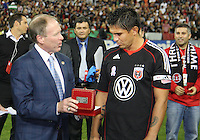 Jaime is presented with a watch by Kevin Payne CEO of D.C. United during festivities surrounding the final appearance of Jaime Moreno in a D.C. United uniform, at RFK Stadium, in Washington D.C. on October 23, 2010. Toronto won 3-2.