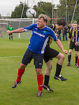 © Joel Goodman - 07973 332324 . 22/09/2013 . Lancing , UK . Shadow Chancellor ED BALLS heads the ball during the 2nd half of the Labour Party vs journalists football match . Day 1 of the Labour Party 's annual conference in Brighton . Photo credit : Joel Goodman