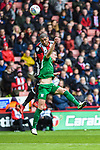 Leon Clarke of Sheffield Utd challenges Ben Davies of Preston North End during the Championship league match at Bramall Lane Stadium, Sheffield. Picture date 28th April, 2018. Picture credit should read: Harry Marshall/Sportimage