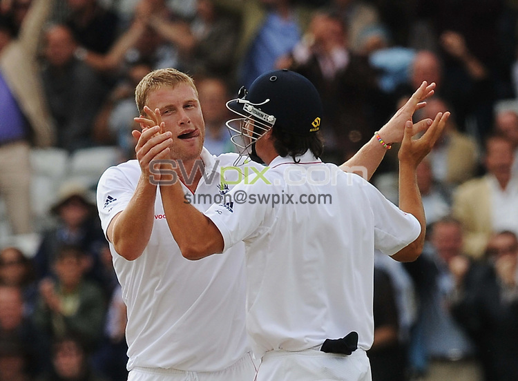 PICTURE BY ALEX BROADWAY/SWPIX.COM - Cricket - The Ashes 2009, 2nd Test - England v Australia, Day Two - Lord's, London, England - 17/07/09...Copyright - Simon Wilkinson - 07811267706...Andrew Flintoff & Alistair Cook of England celebrate the wicket of Australia's Mike Hussey.