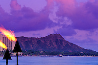 Diamond head at twilight with torches