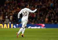 Pictured: Jonathan de Guzman of Swansea celebrating his goal with a penalty kick. Sunday 24 February 2013<br /> Re: Capital One Cup football final, Swansea v Bradford at the Wembley Stadium in London.